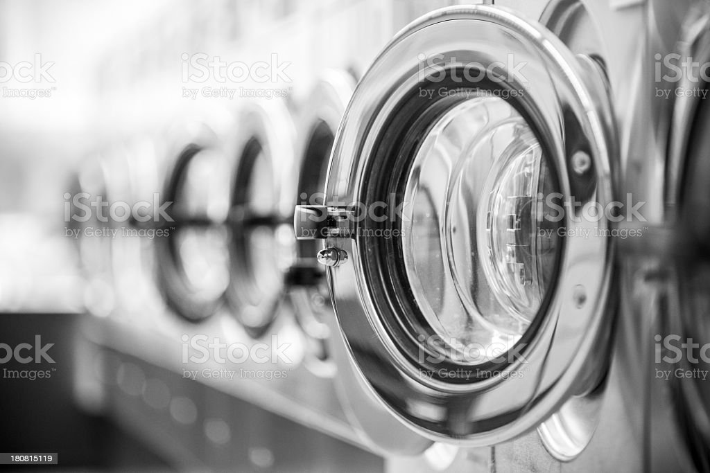 Washing machines - clothes washer's door in a public launderette stock photo