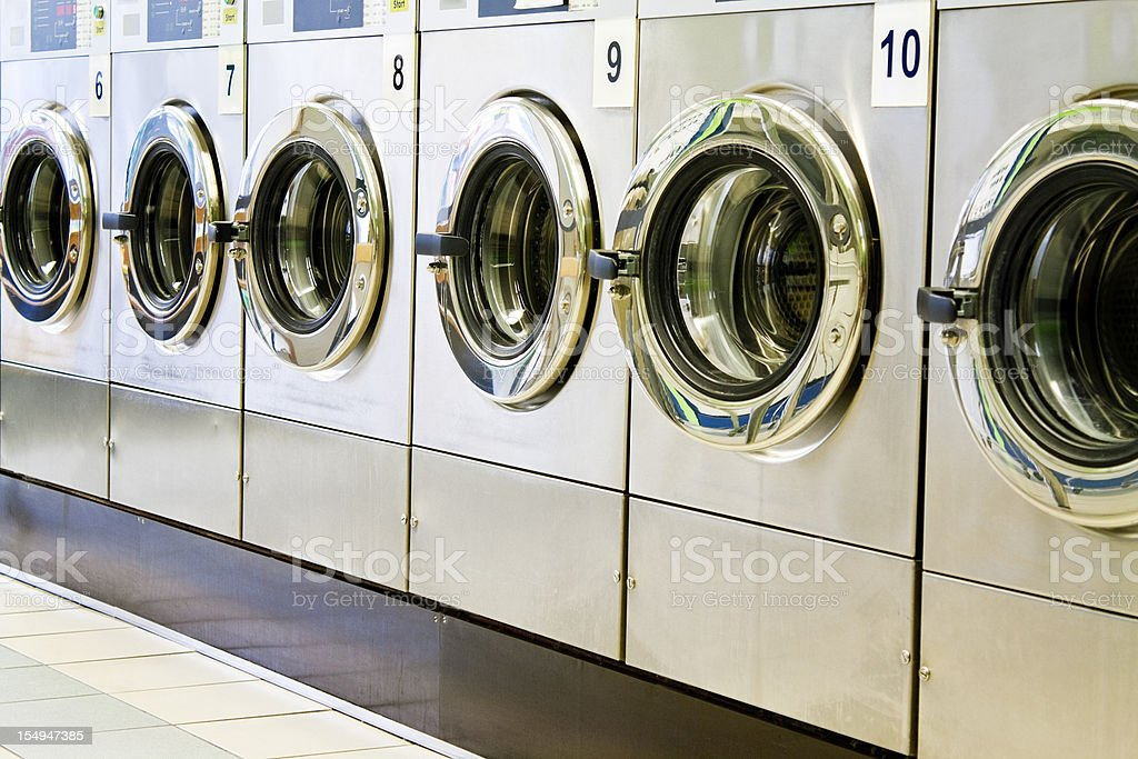 Washing machines in a public launderette stock photo