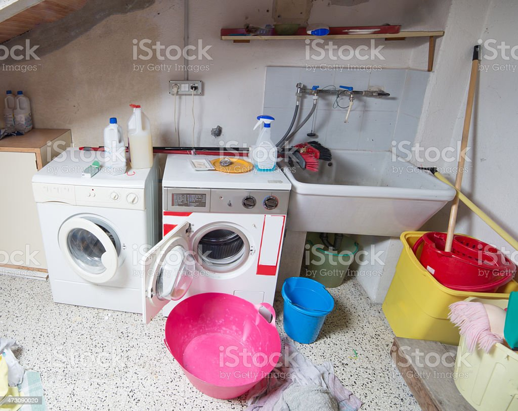 washing machines in the laundry room in the attic stock photo