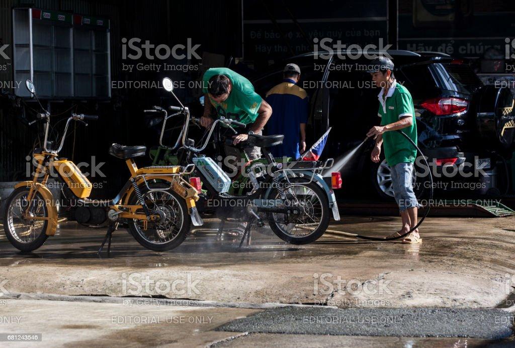 Washing motorcycle stock photo