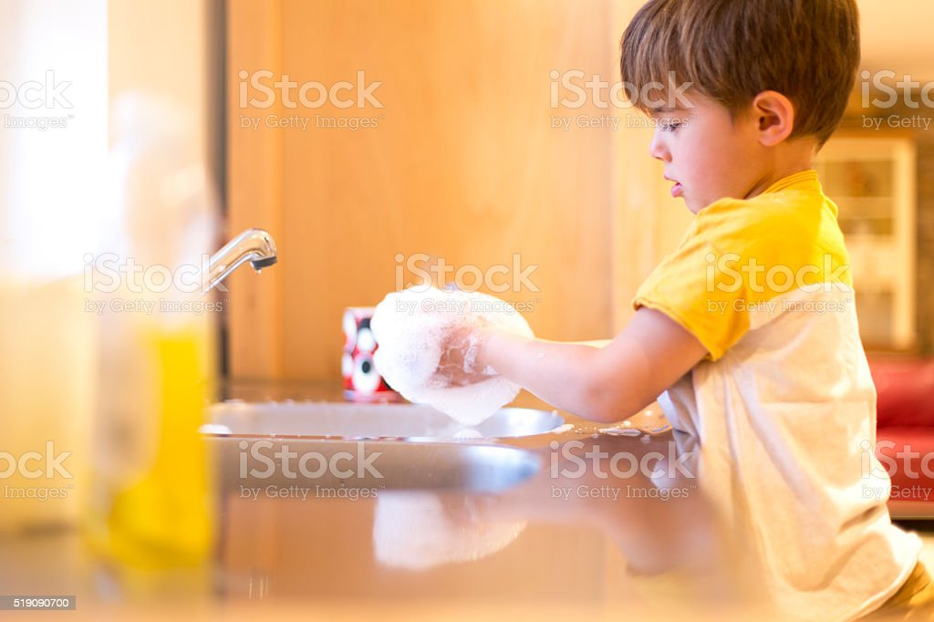Washing my own dishes stock photo