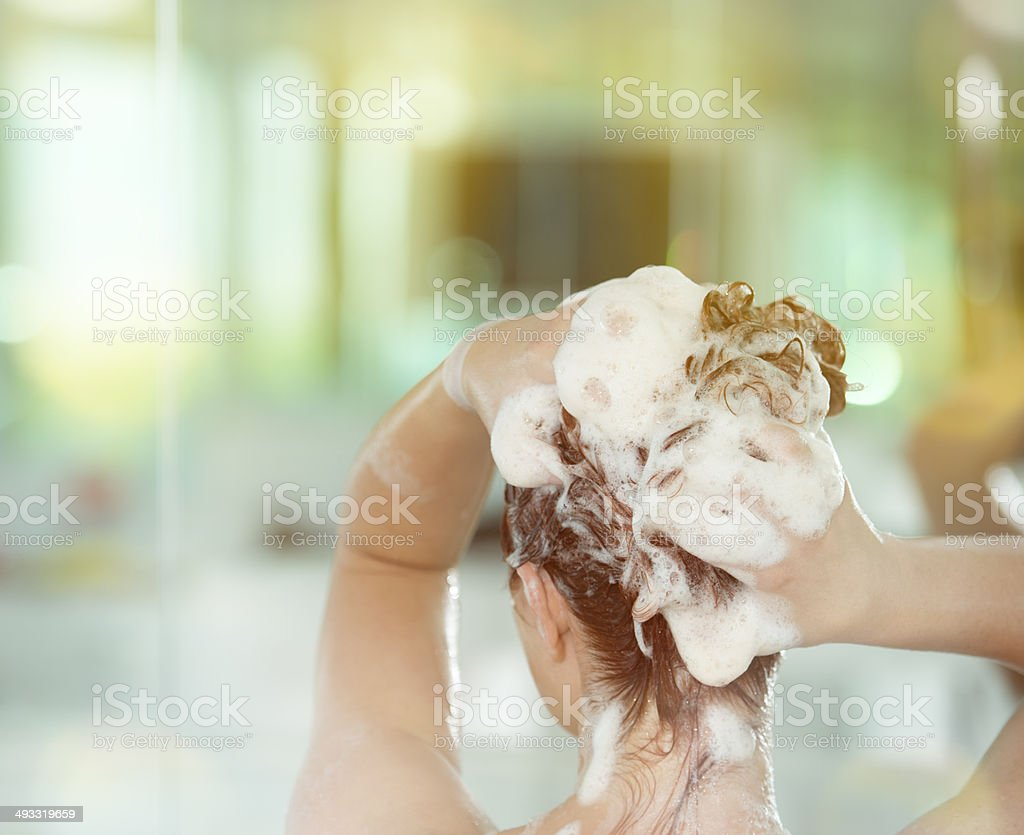 washing red hair stock photo