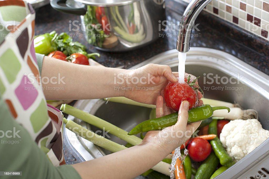 Washing Vegetables stock photo