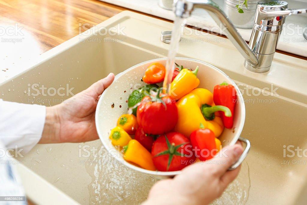Washing Vegetables Under Running Water stock photo