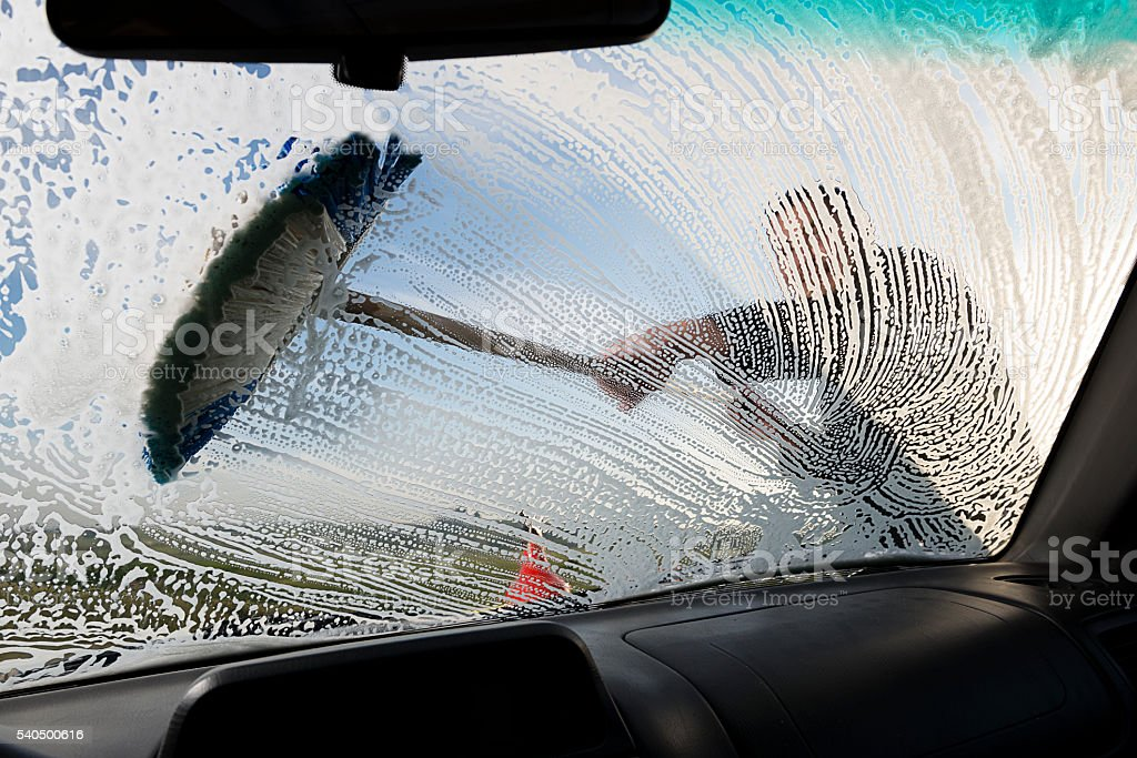 Washing Window with Brush stock photo