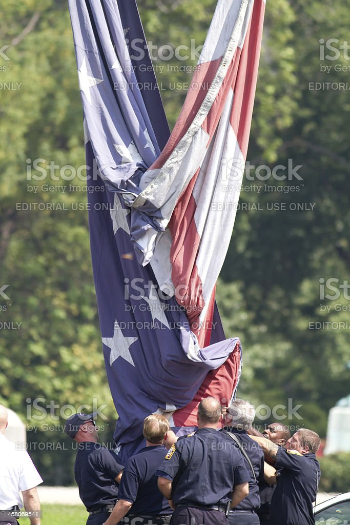 Washington DC Fire Department Members Raise A Flag In Honor stock photo