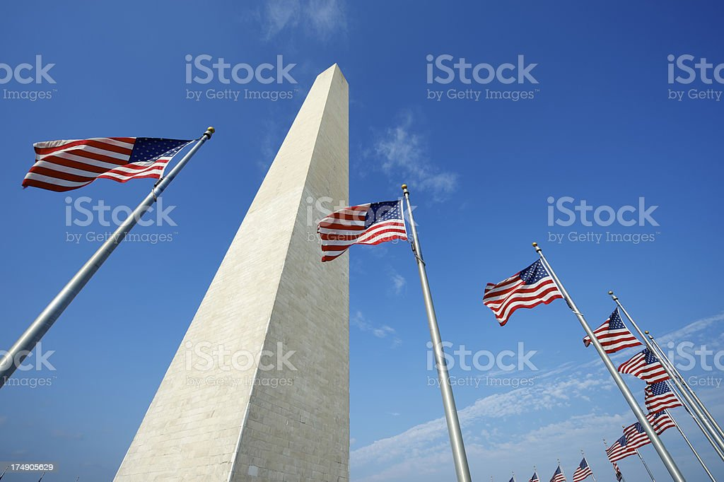 Washington Monument American Flags Blue Sky stock photo