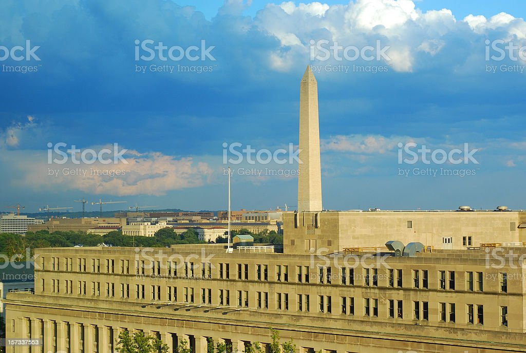 Washington Monument and Department of Interior after storm stock photo