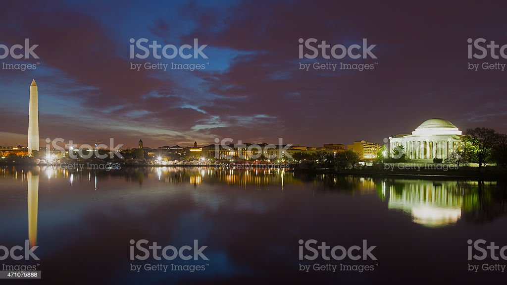 Washington Monument and Jefferson Memorial at night with city skyline. stock photo