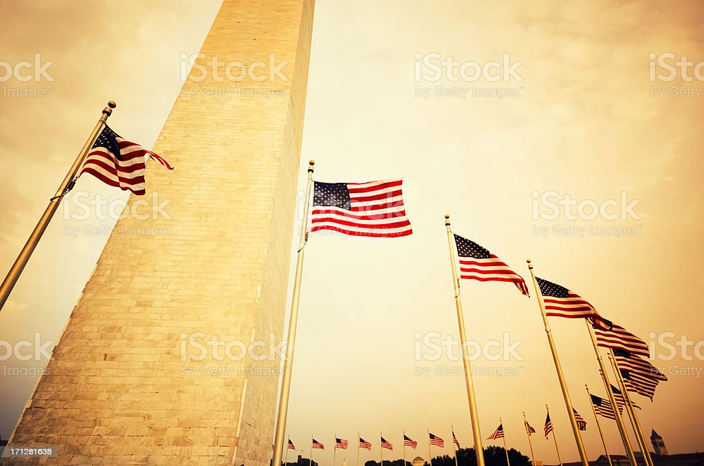 Washington Monument and US flag royalty-free stock photo