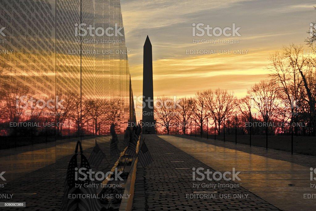 Washington Monument and Vietnam Memorial Wall at Sunrise stock photo