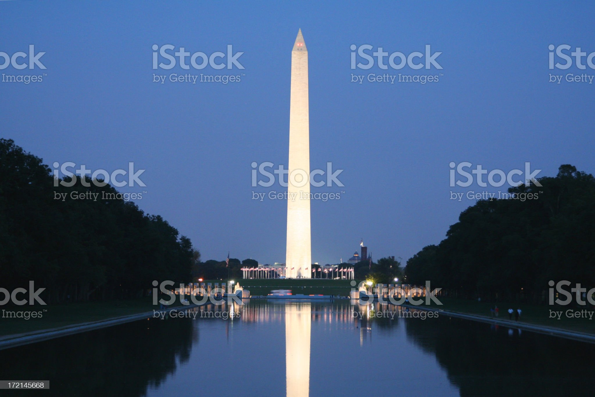 A Washington monument illuminated at night royalty-free stock photo