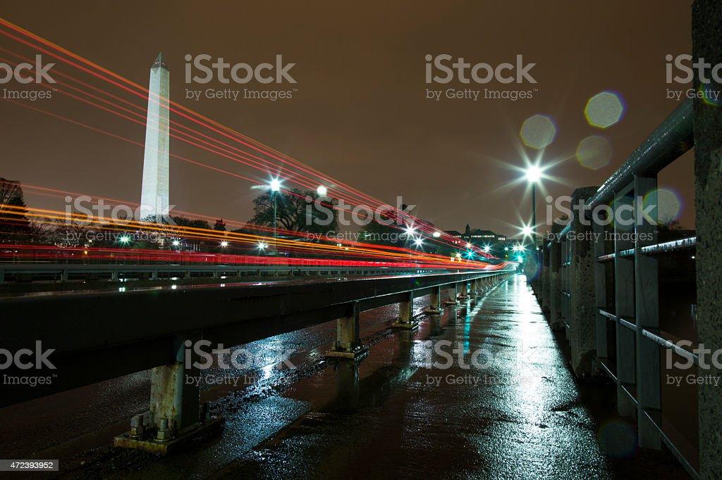 Washington Monument Lit Up at Night in the Rain stock photo