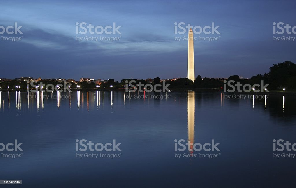 Washington Monument lit up at night with water in the front royalty-free stock photo