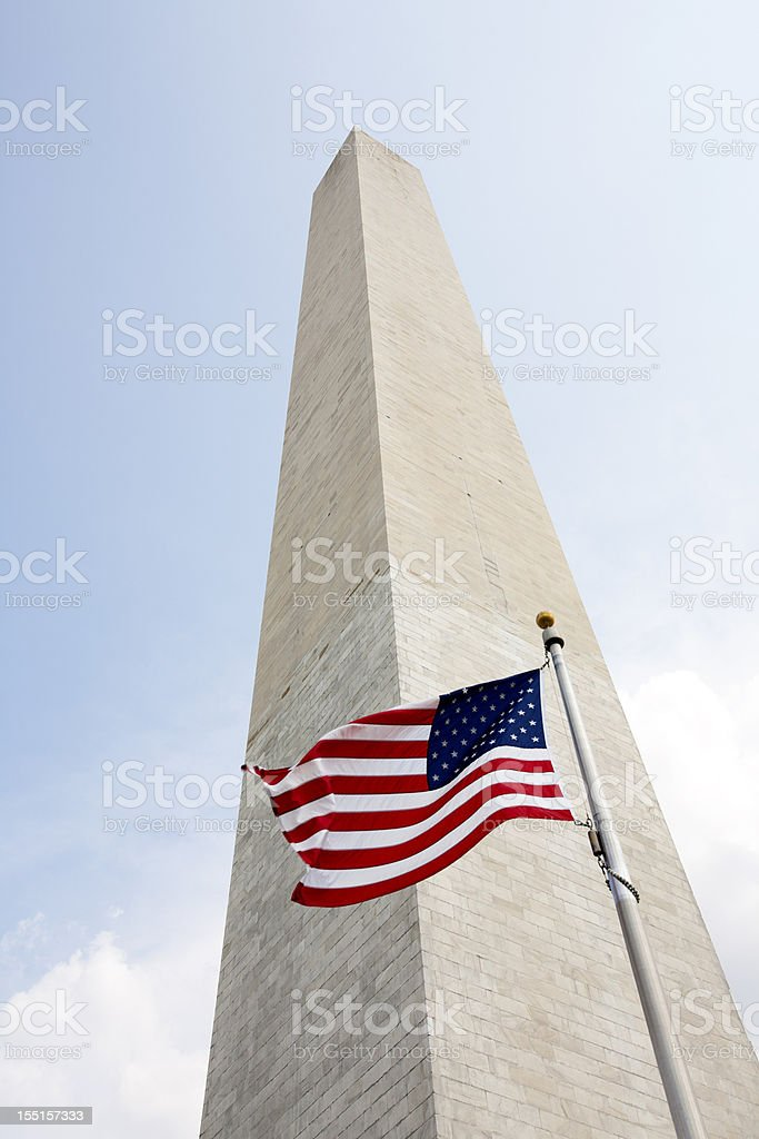 A Washington monument with the American flag stock photo