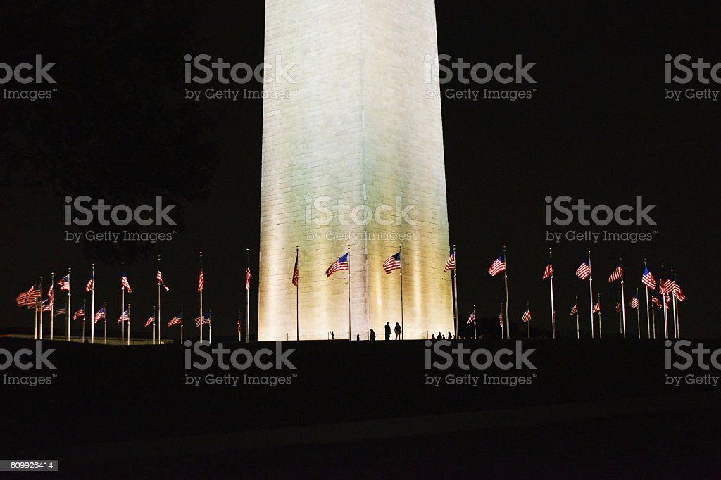 Washington Monument with US Flags at Night stock photo