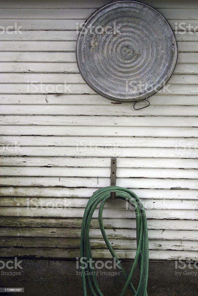 Washtub and Hose stock photo
