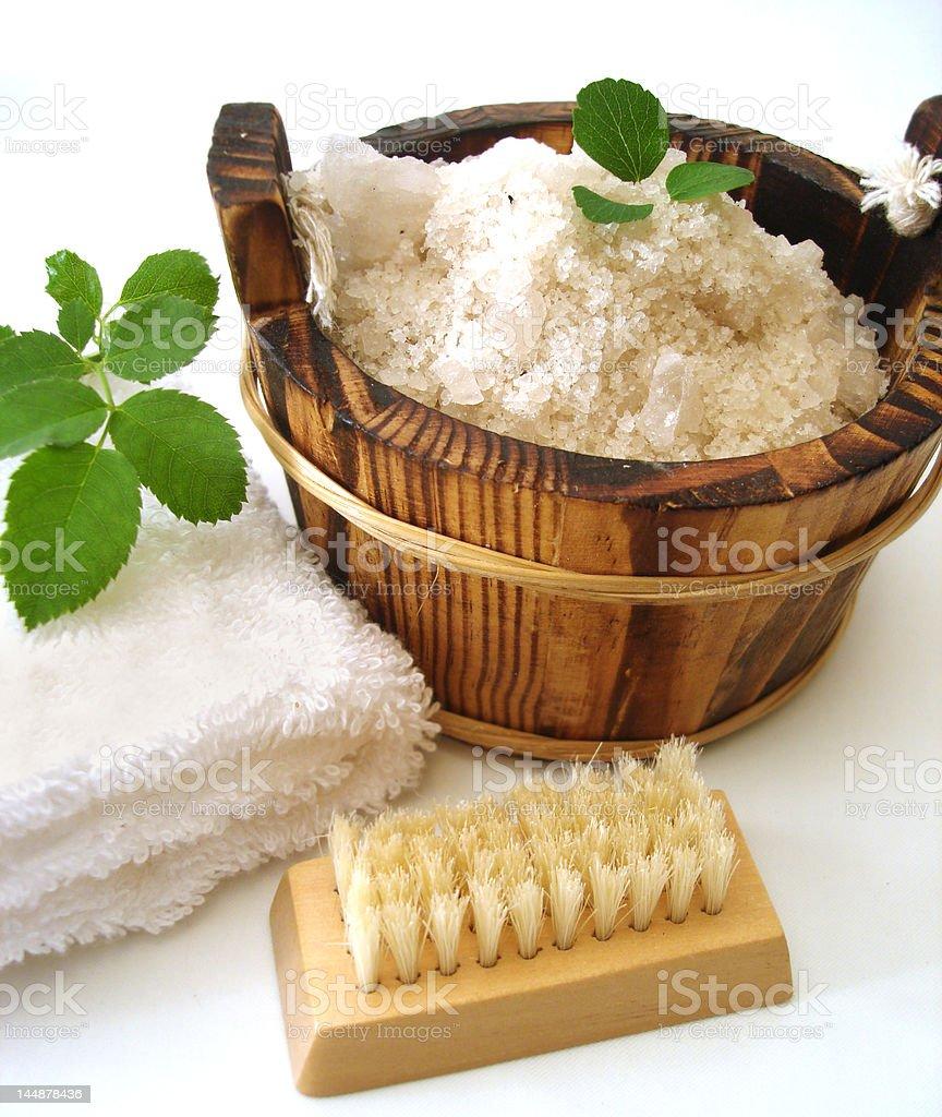 washtub with bath salt, comb, towel and brush royalty-free stock photo