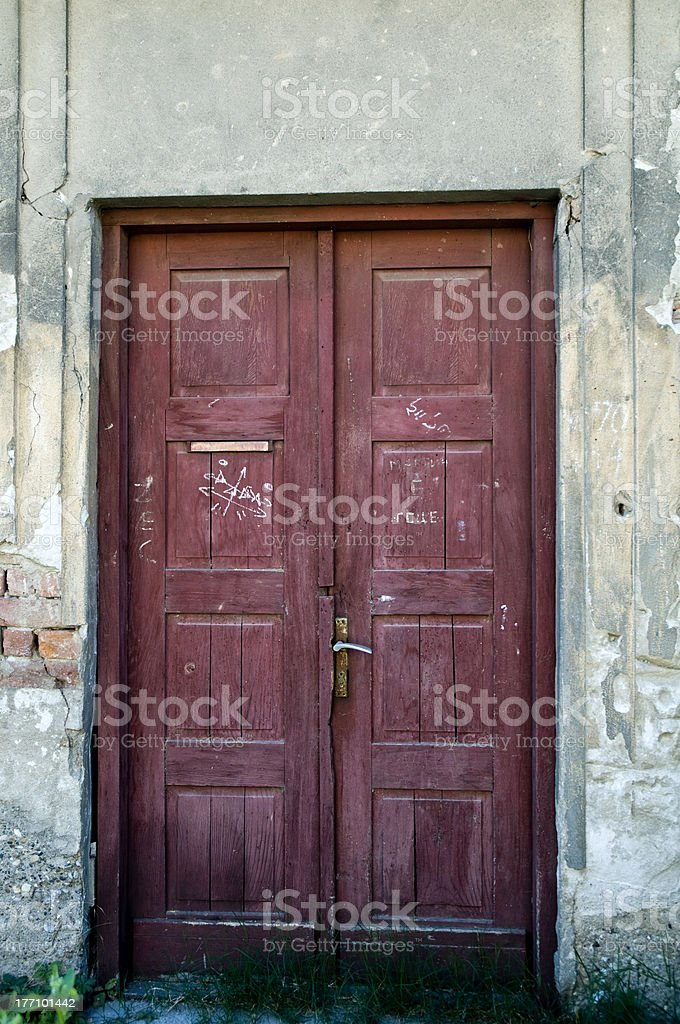 washy and rusty two sided door stock photo