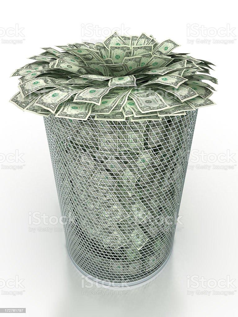 Waste basket stuffed with dollars stock photo