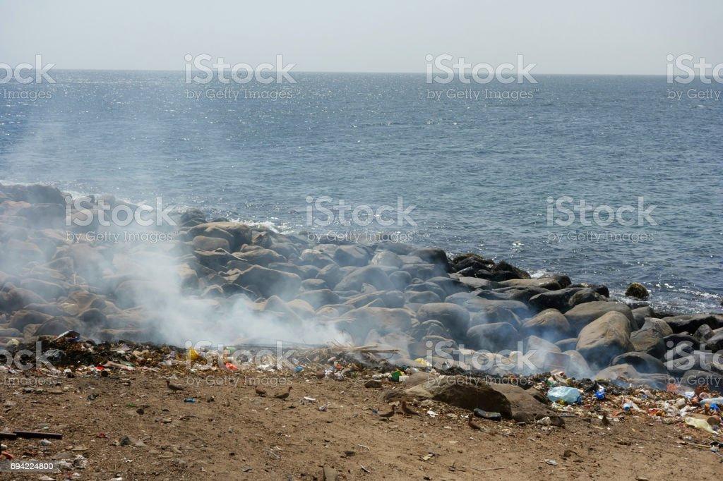 Waste disposal on Ile de Goree Island, Dakar, Senegal stock photo