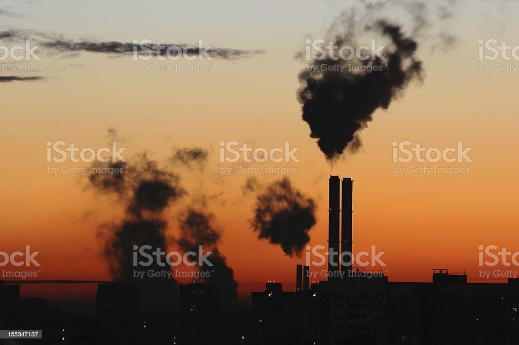 Waste gas fumes emission in sunset/sunrise stock photo