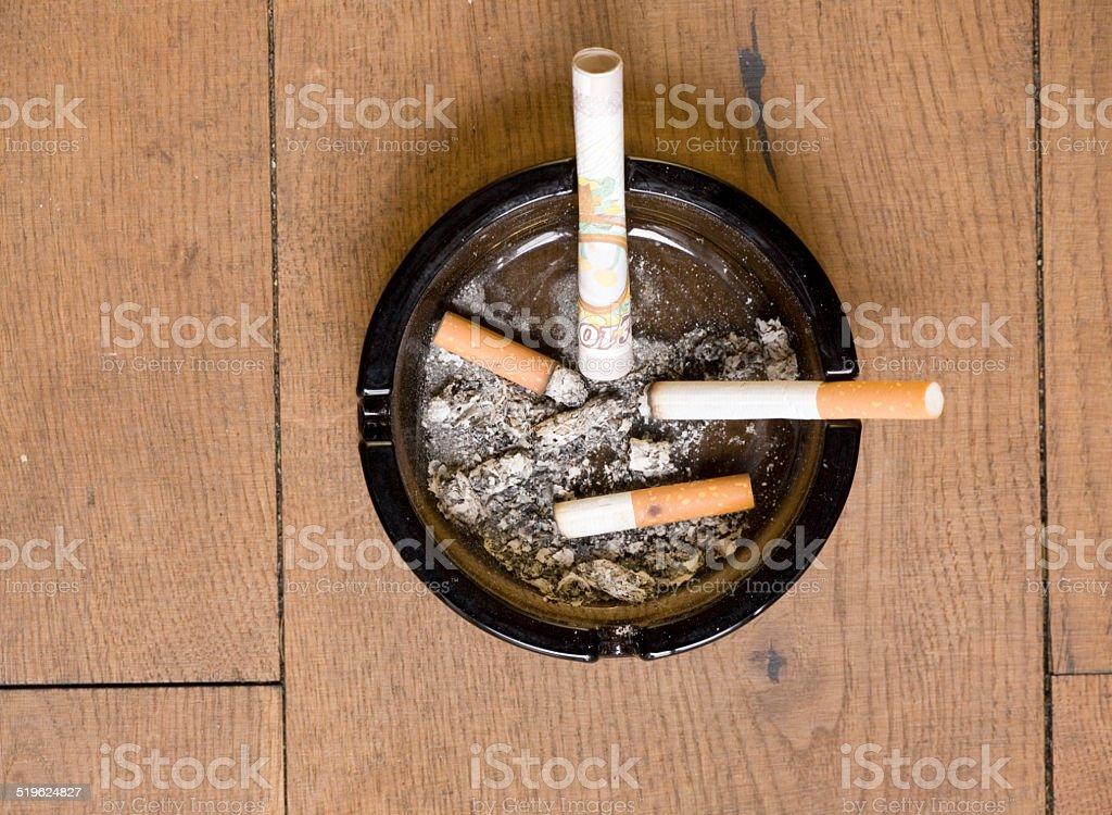Waste of money smoking stock photo