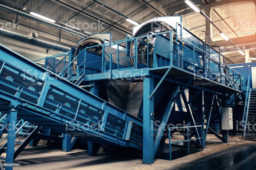 Waste processing plant. Technological process. Recycling and storage of waste for further disposal. Business for sorting and processing of waste. stock photo