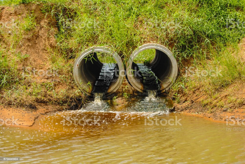 Waste water is discharged from the industrial sewage pipe. stock photo