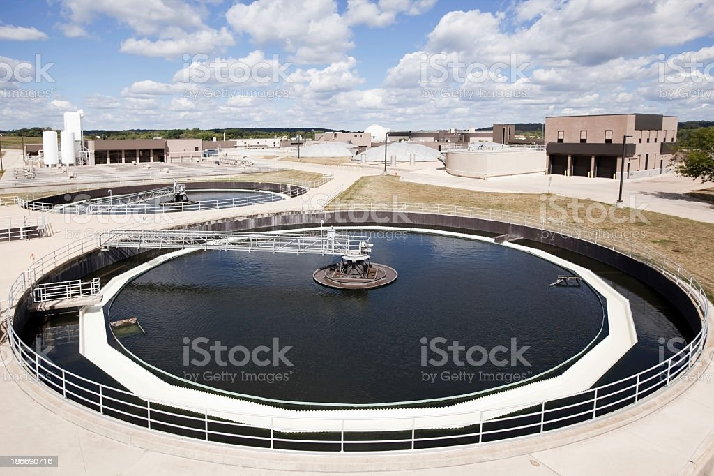 Waste Water Treatment  Clarifier Tank with Plant Background stock photo