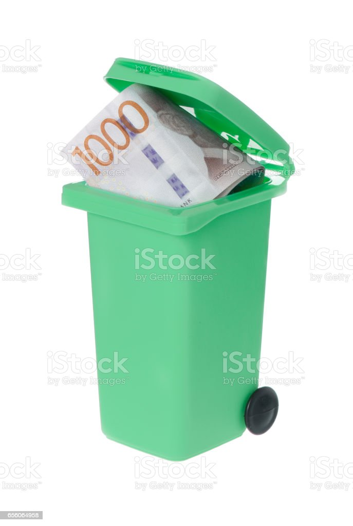 Wasted money in a recyle bin stock photo