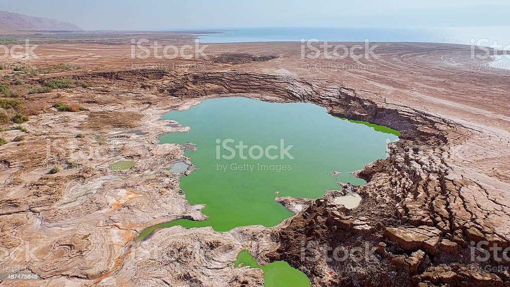 Wasteland with the pond full of toxic water stock photo