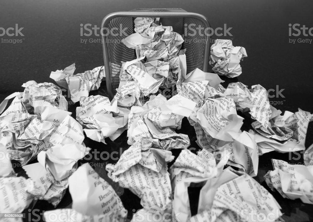 Wastepaper basket lay down stock photo
