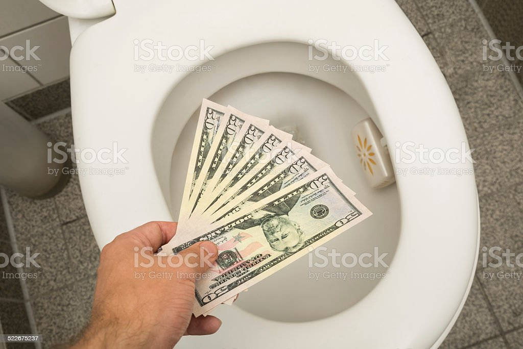 Wasting money concept stock photo