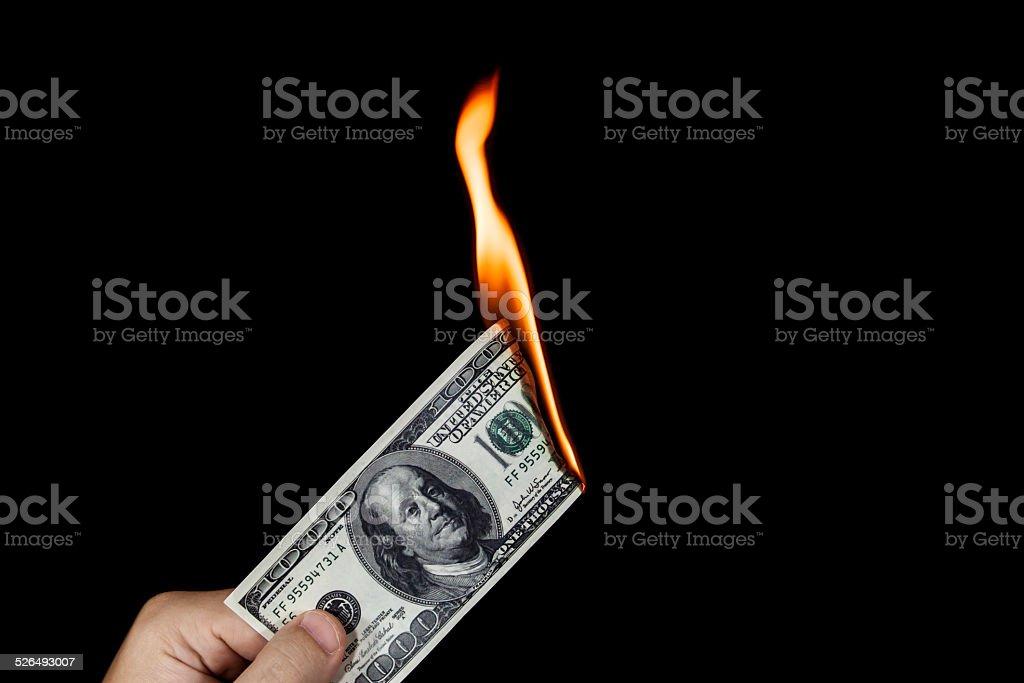 Wasting money stock photo