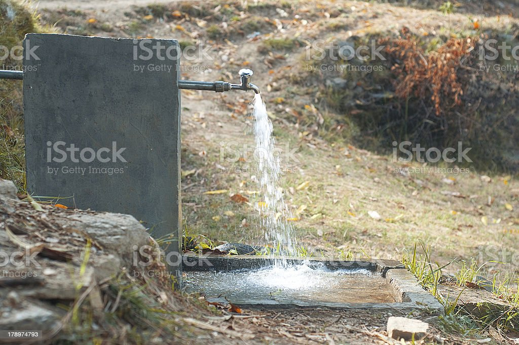 wasting water stock photo