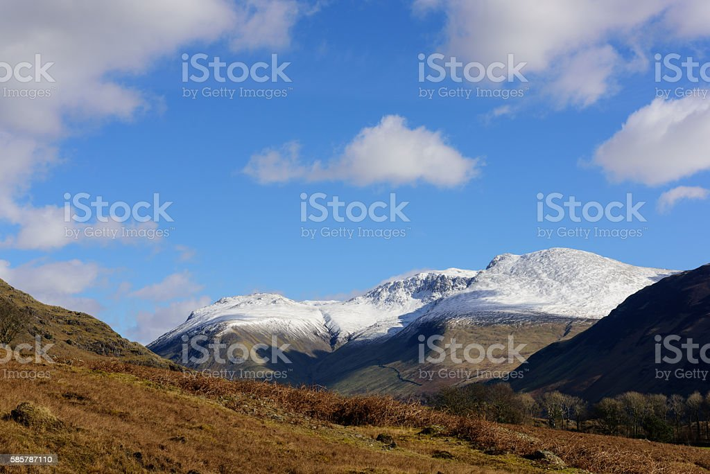 Wastwater with snow capped  Lingmell, Scafell pike and Scafell stock photo