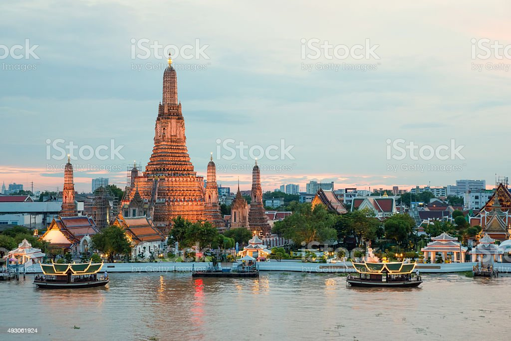 Wat Arun and cruise ship in night ,Bangkok city ,Thailand stock photo