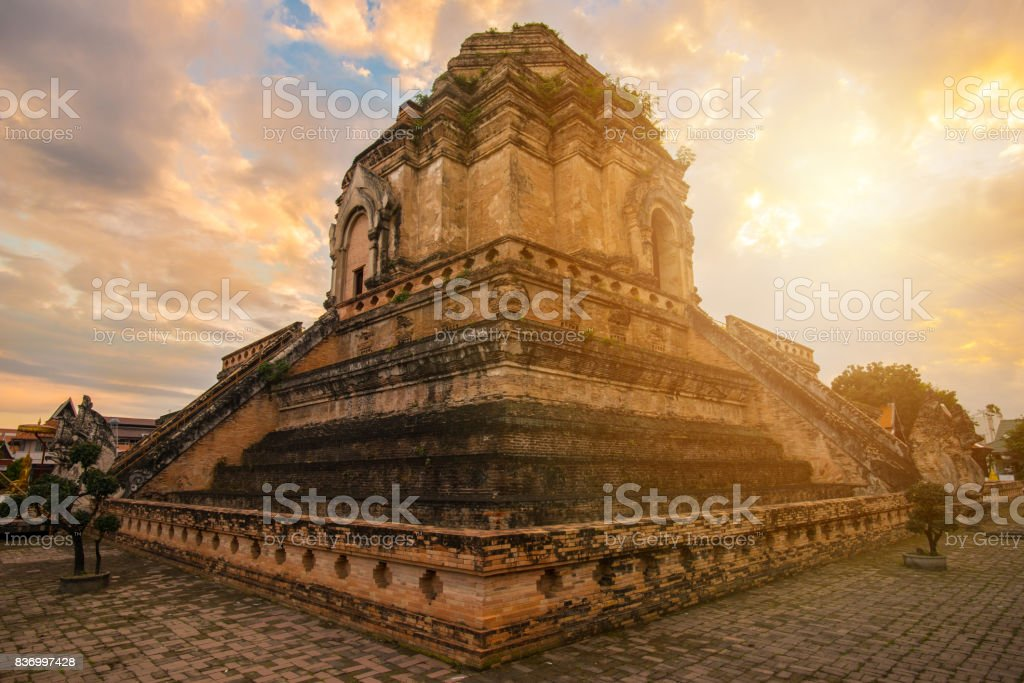 Wat Chedi Luang at sunset this place is one of the most tourist attraction in Chiang Mai province of Thailand. stock photo