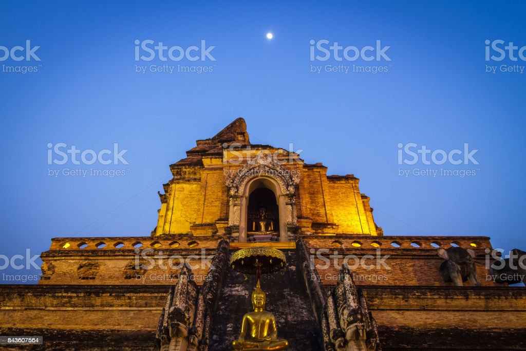 Wat Chedi Luang temple after sunset in Chiang Mai, Thailand. stock photo