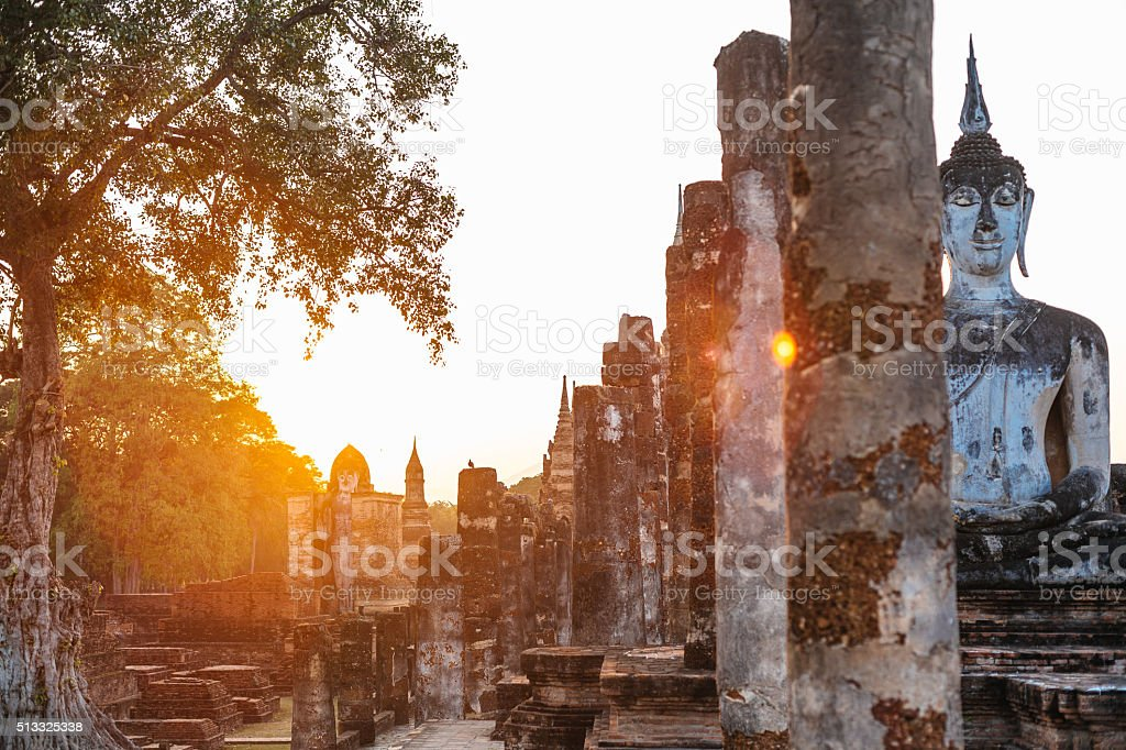 Wat Mahathat at sunset, view of Buddha statue in Sukhothai stock photo