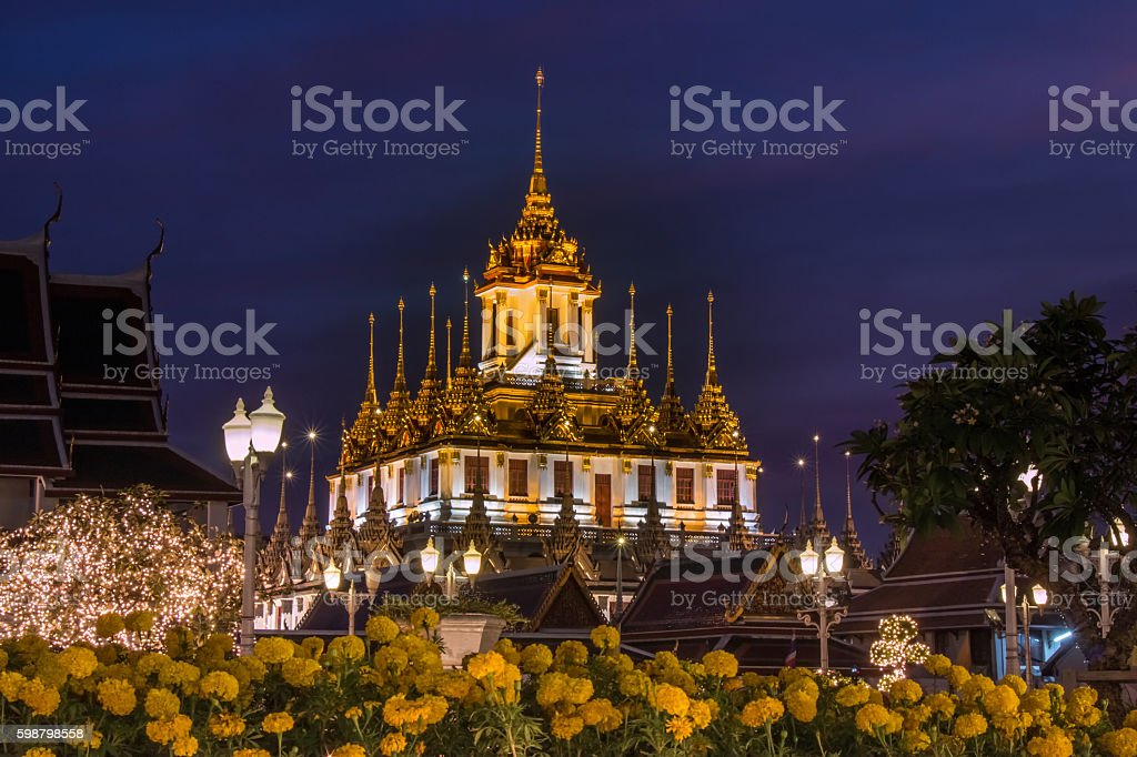 Wat Ratchanaddaram and Loha Prasat Metal Castle stock photo