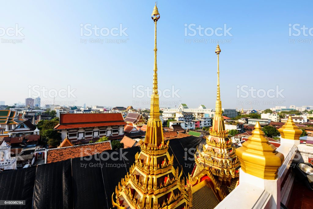 Wat Ratchanatdaram (Loha Prasat) with Bangkok skyline view stock photo