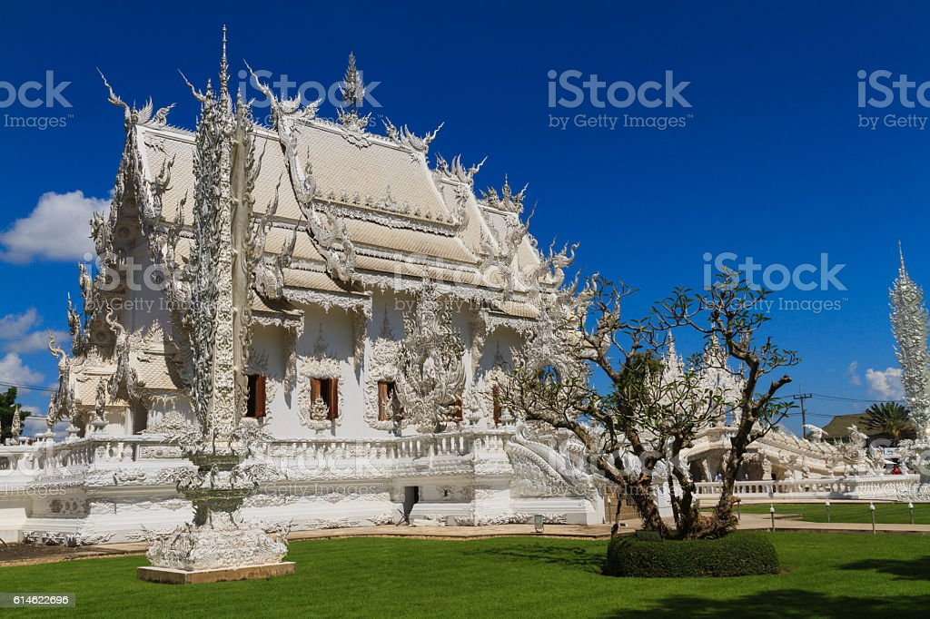 Wat Rong Khun side view. stock photo