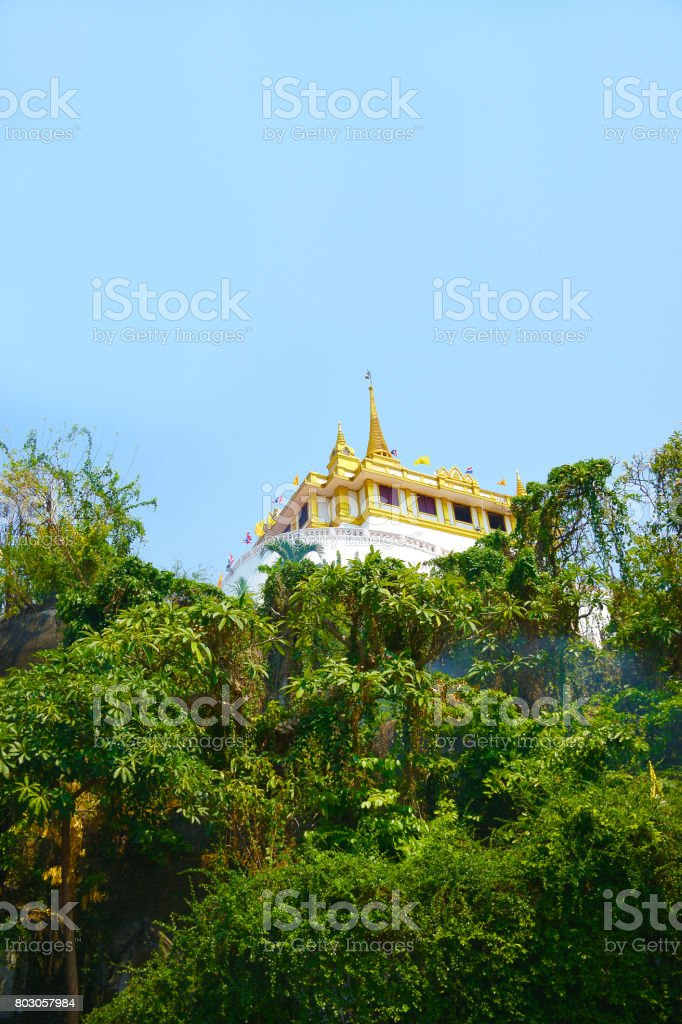Wat Sraket Rajavaravihara in the forest with mist and blue sky ,Bangkok Thailand'n stock photo