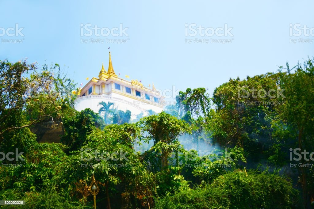 Wat Sraket Rajavaravihara in the forest with mist and blue sky ,Bangkok Thailand stock photo