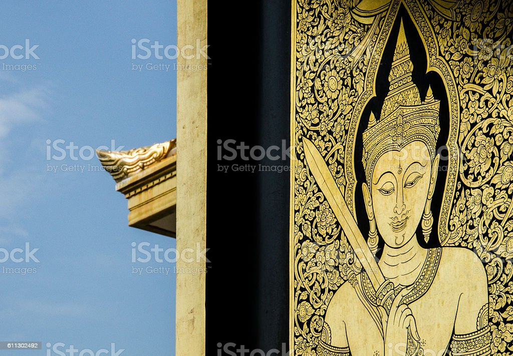 Wat Traimit Golden Engravement with Blue Sky Background stock photo
