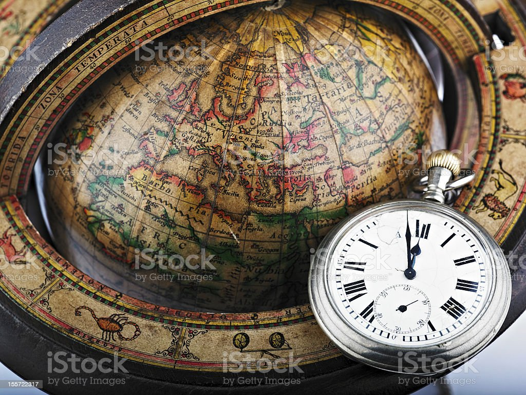 Watch and  antique globe royalty-free stock photo