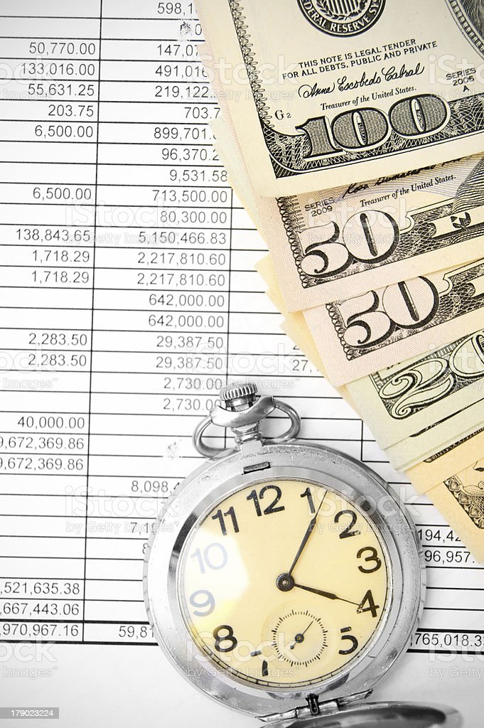 Watch and dollars on the documents. royalty-free stock photo