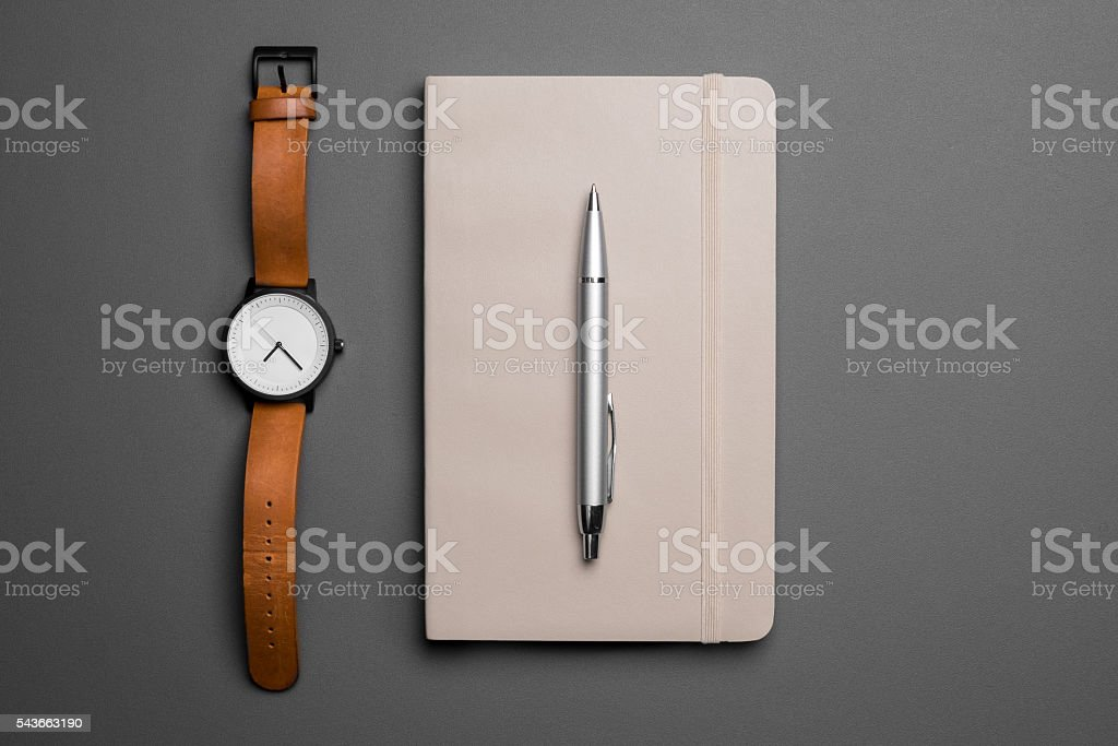 Watch and notebook with pen stock photo